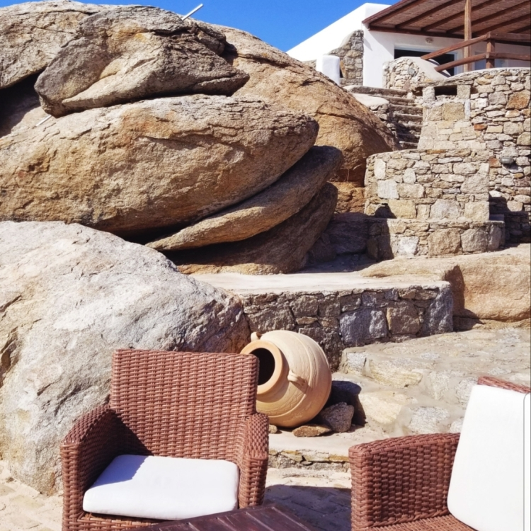 The white and brown chairs and the rock wall by the pool at our AirBNB made everything feel luxurious.