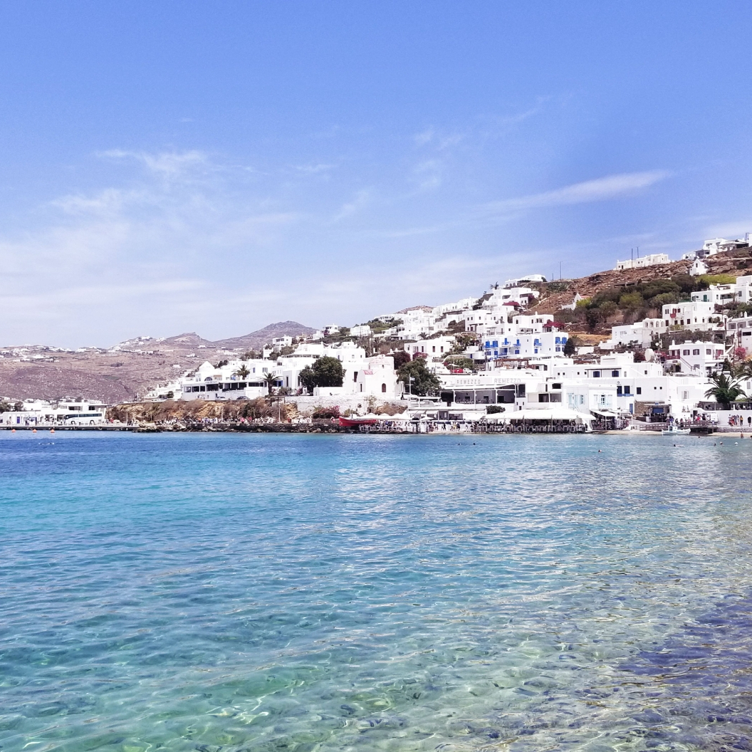 View of the white houses on the cliff from Mykonos Town